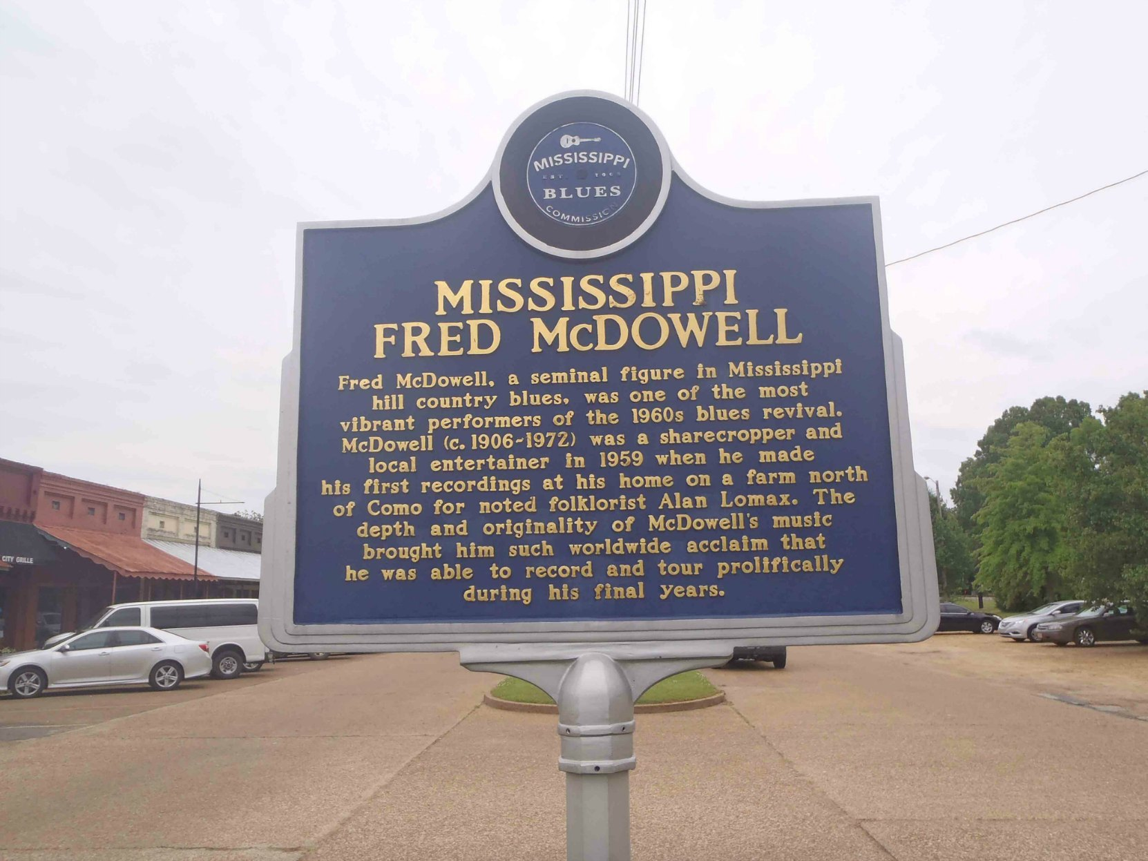 Mississippi Blues Trail marker for Missisippi Fred McDowell, Como, Mississippi