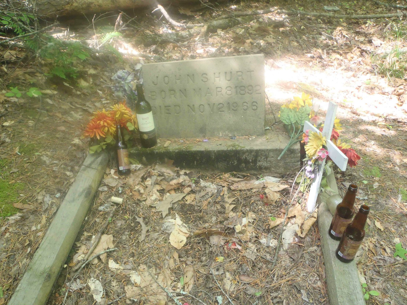 Mississippi John Hurt's grave, Avalon, Mississippi, with tributes left by fans.