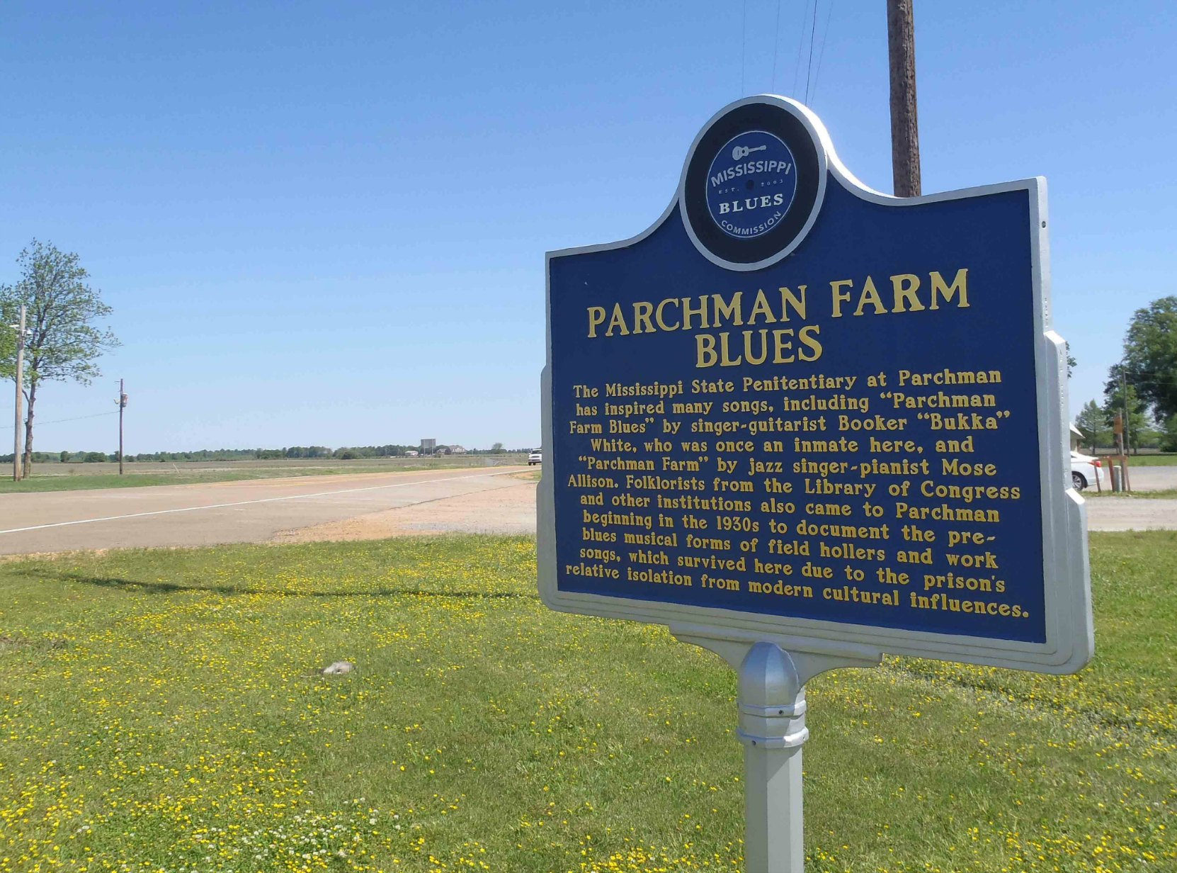 Miississippi Blues Trail marker for Parchman Farm Blues near the main gate of the Mississippi State Penitentiary