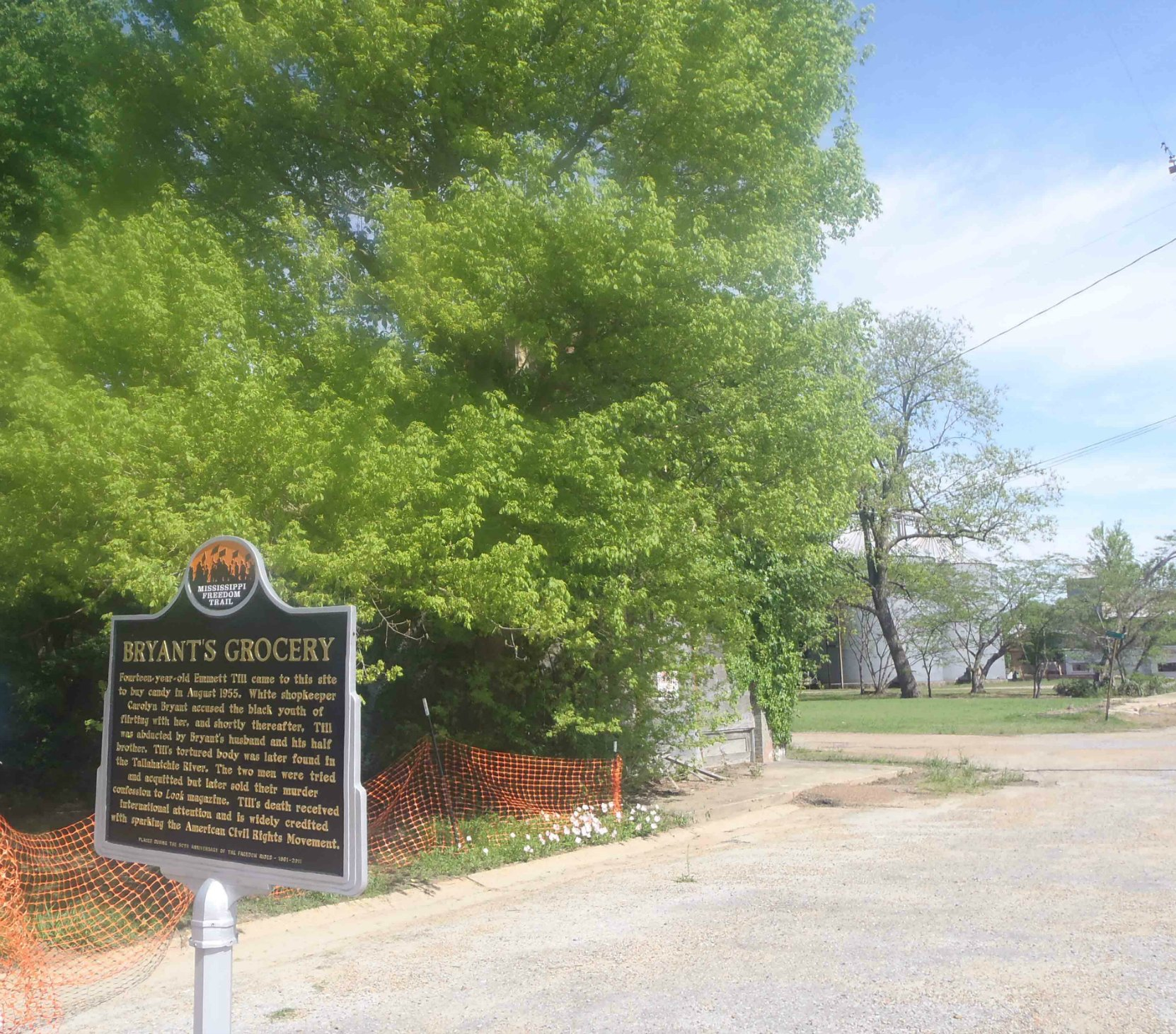 The site of Bryant's Grocery, Money, Leflore County, Mississippi. This ruins of the former Bryant's Grocery building are behind the trees to the rear of the Freedom Trail marker.