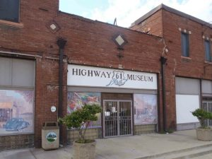 "The Highway 61 Blues Museum, North Broad Street, Leland, Mississippi. The Mississippi Blues Trail markers for James ""Son"" Thomas and Johnny Winter are nearby."