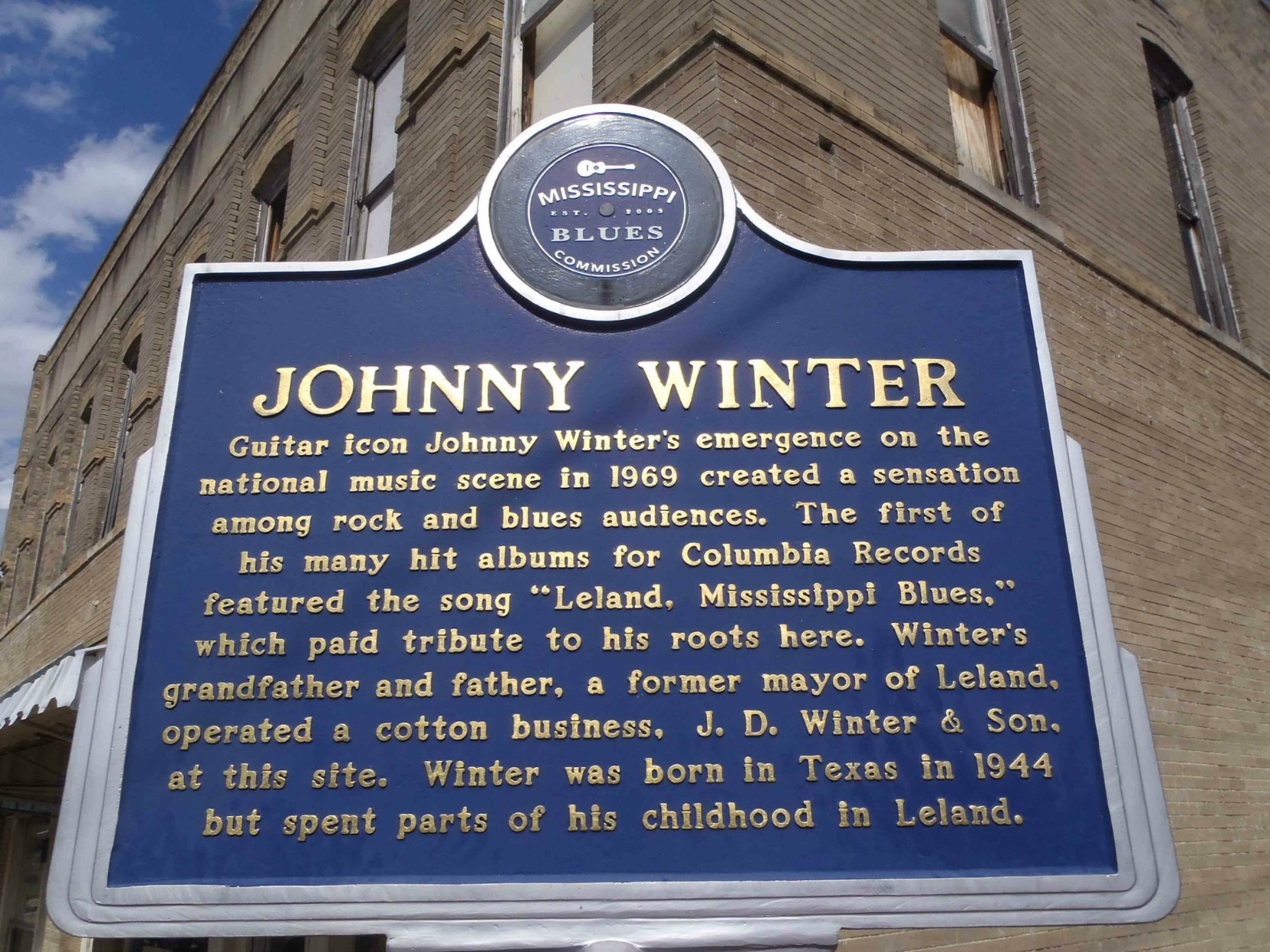 The Mississippi Blues Trail marker for Johnny Winter, Leland, Mississippi