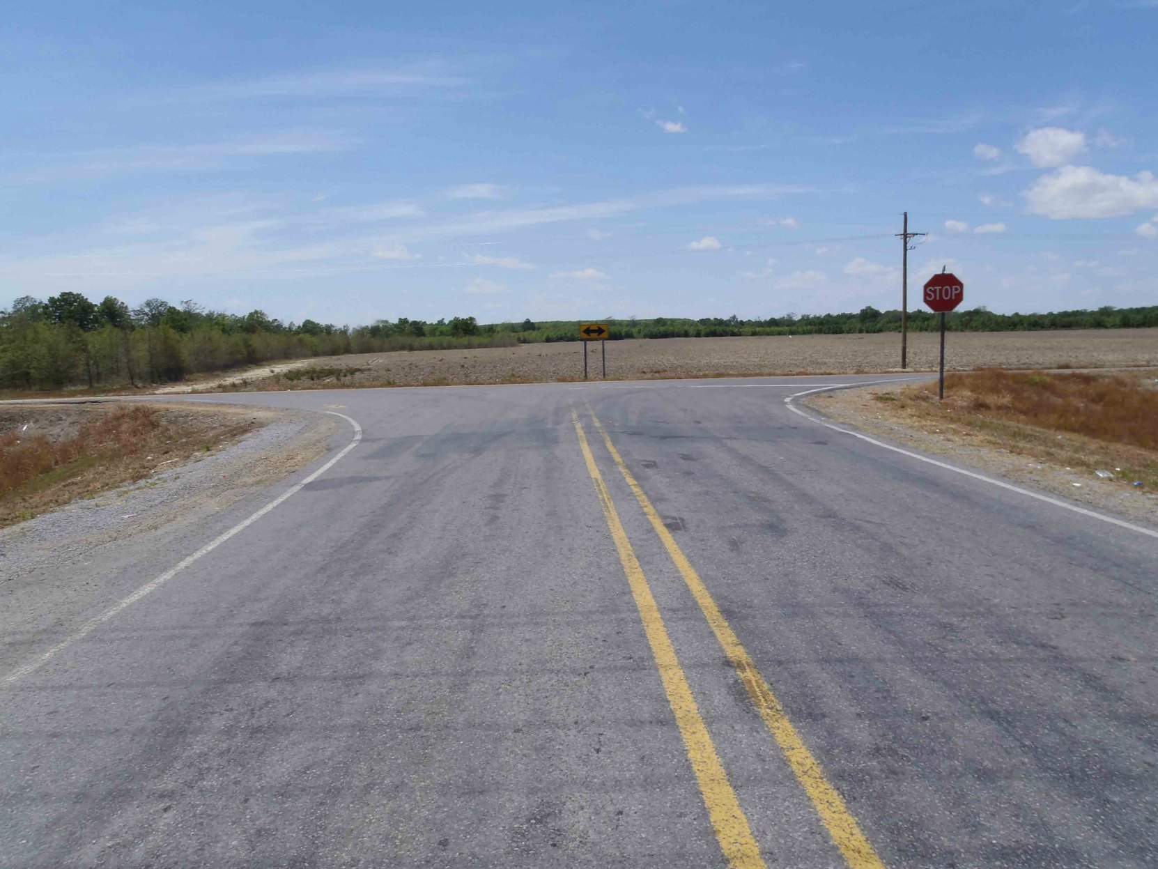 The second reputed site of Robert Johnson's poisoning in 1938, Highway 7 and Leflore County Road 512, near Quito, Leflore County, Mississippi, looking west.