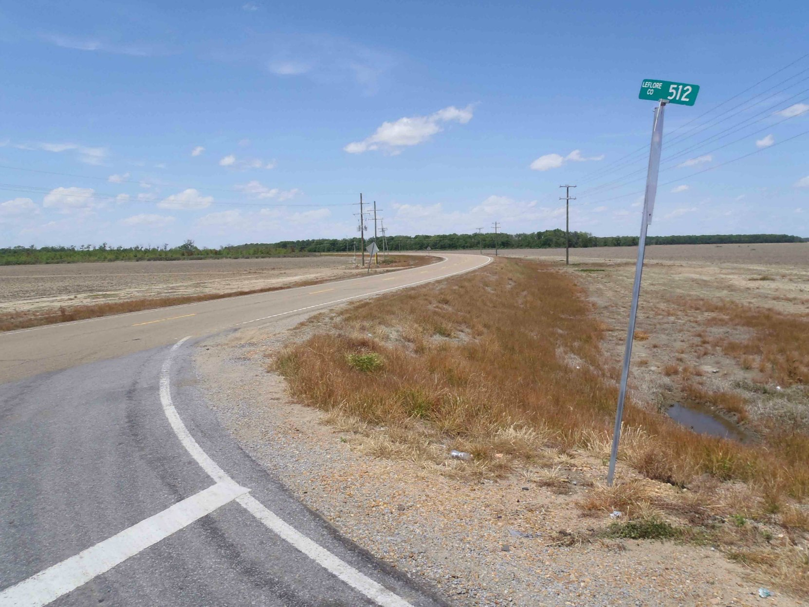 The second reputed site of Robert Johnson's poisoning in 1938, Highway 7 and Leflore County Road 512, near Quito, Leflore County, Mississippi, looking north.