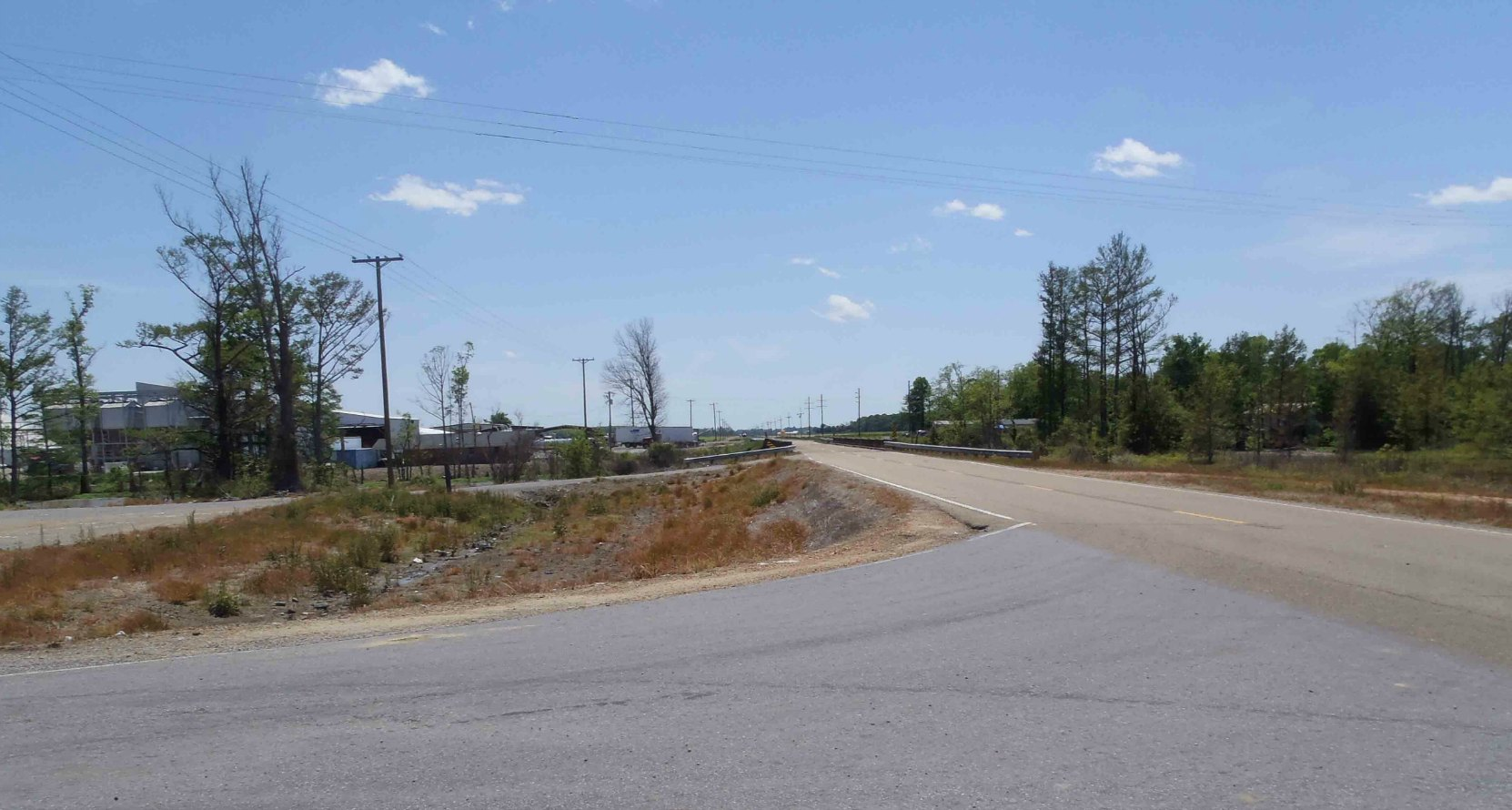 The second reputed site of Robert Johnson's poisoning in 1938, Highway 7 and Leflore County Road 512, near Quito, Leflore County, Mississippi, looking south.