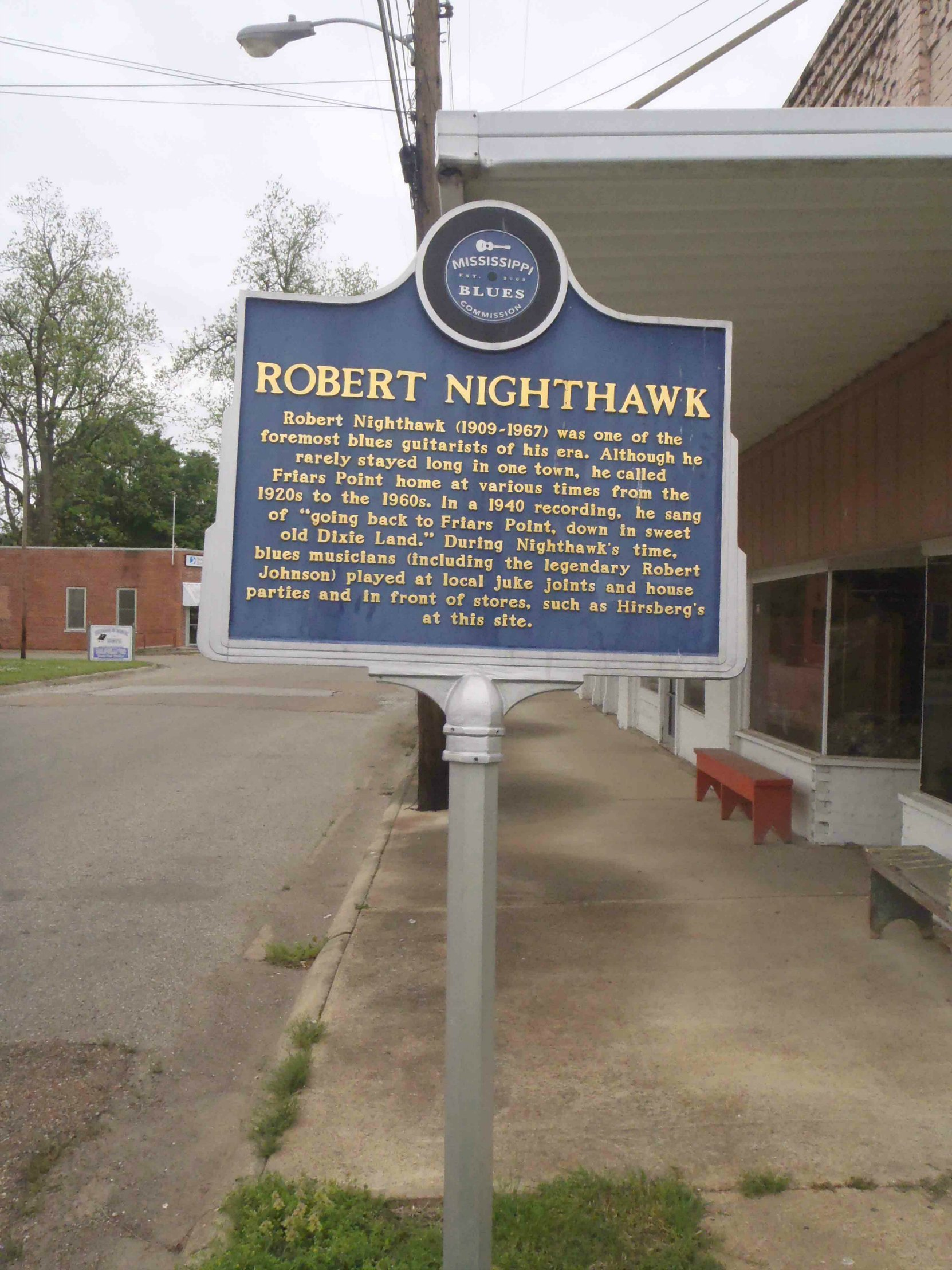 The Mississippi Blues Trail marker for Robert Nighthawk, outside the building that was once Hirsbergs Drug Store in Friars Point, Mississippi