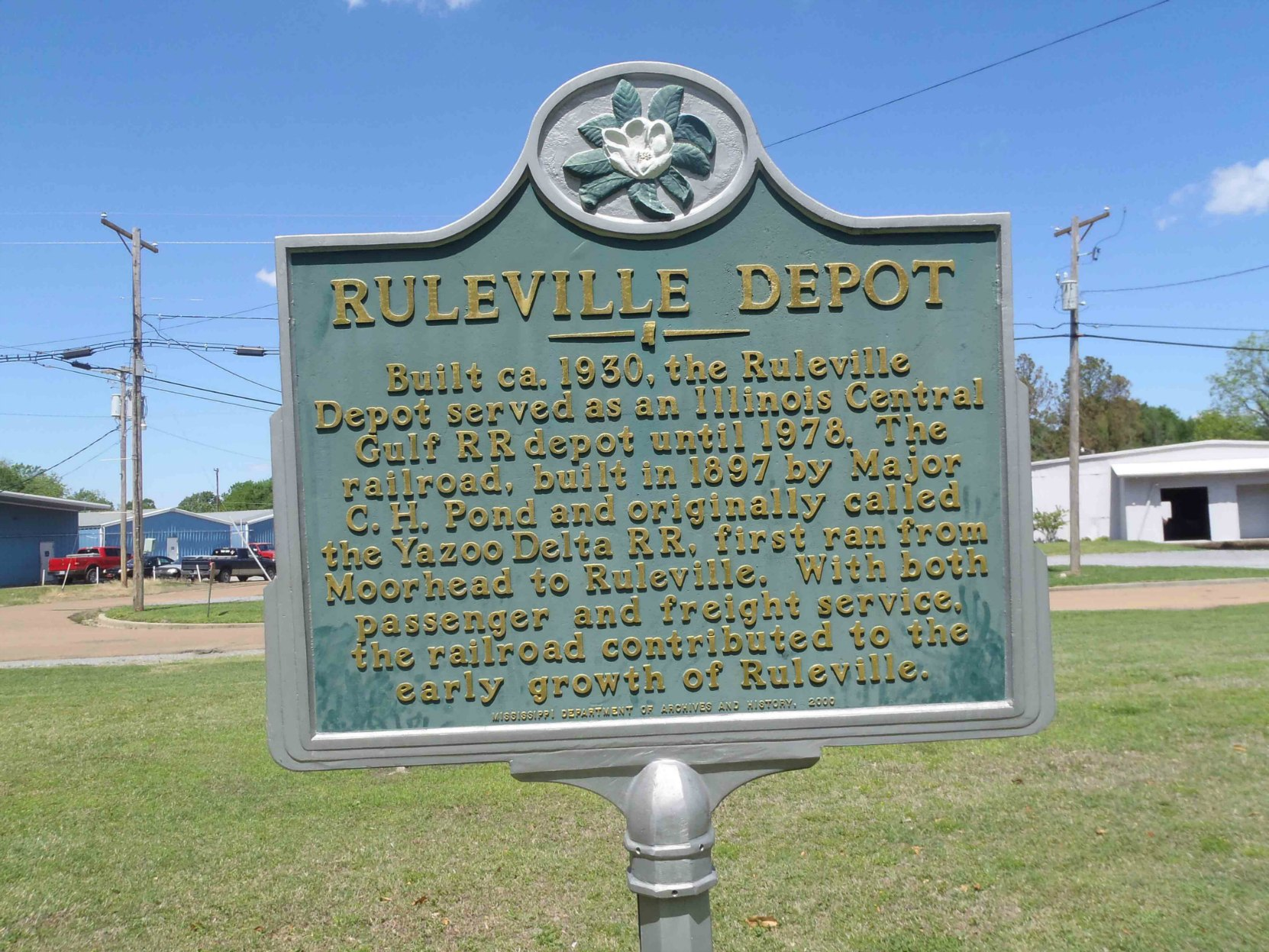 The Mississippi Department of Archives & History marker for the Ruleville Rail Depot building, now the Ruleville Chamber of Commerce, Ruleville, Sunflower County, Mississippi.