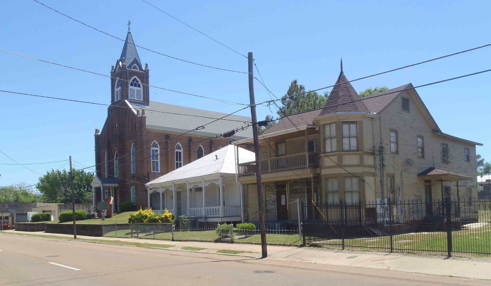 Holy Family Catholic Church, Natchez, Mississippi and some of the adjacent neighborhood houses.