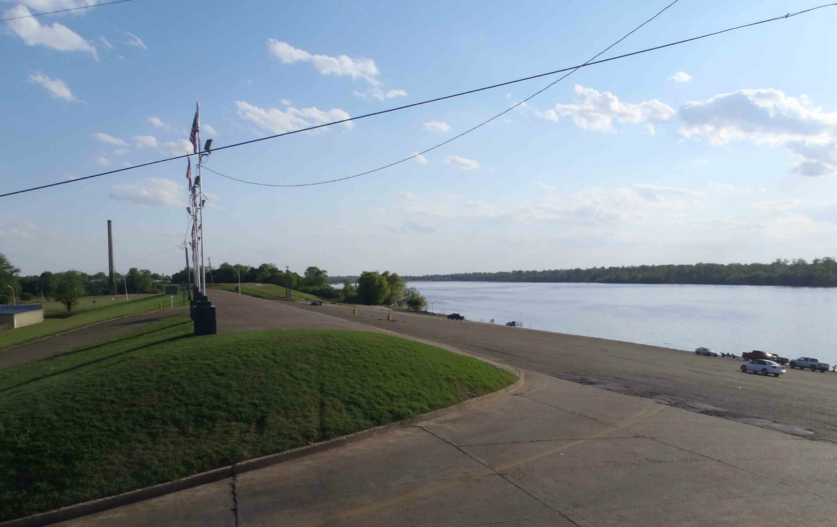 The top of the Mississippi River levee at Greenville, Mississippi. The cars on the right of the photo give an indication of the height of the levee at Greenville.