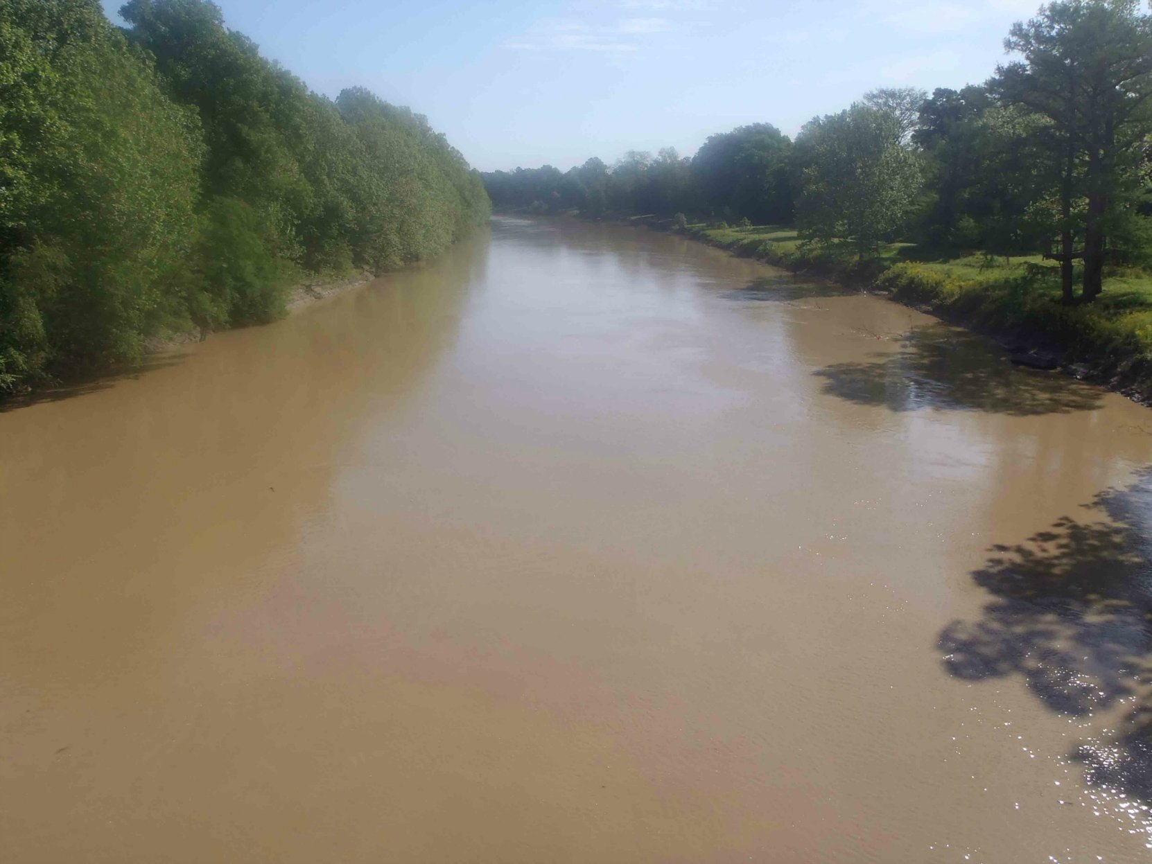 "The Tallahatchee River, as seen from the ""Tallahatchee Bridge"" on Grand Avenue, Greenwood, Mississippi, near the Mississippi Country Music Trail marker for Bobbie Gentry"