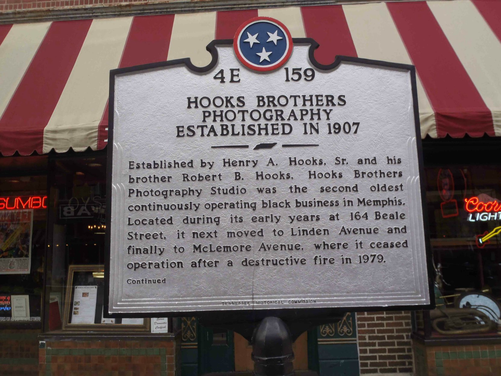 Tennessee Historical Commission marker (front) for Hooks Brothers Photography, outside 164 Beale Street, Memphis